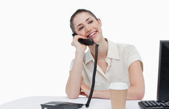 Laughing secretary answering the phone Stock Image