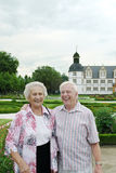 Laughing senior couple. 85 year old woman and 79 year old man senior happy couple laughing in front of a german castle stock image