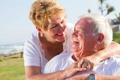 Laughing senior couple. Happy laughing senior couple hugging royalty free stock image