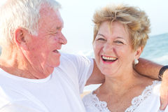 Laughing senior couple. Happy laughing senior couple on beach stock photos