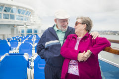Laughing Senior Couple on The Deck of a Cruise Ship. Happy Senior Couple Enjoying The View From Deck of a Luxury Passenger Cruise Ship royalty free stock photos