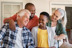 Laughing senior friends with happy women stock images