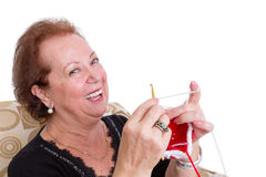 Laughing senior lady sitting knitting Stock Photos