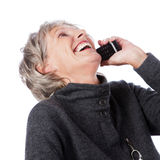 Laughing senior lady on the telephone Stock Image
