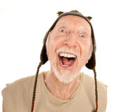 Laughing senior man in knit cap Royalty Free Stock Photography