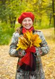 Laughing senior woman. Portrait of laughing senior woman in autumn park royalty free stock image
