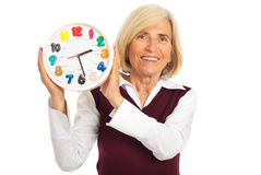 Laughing senior woman holding clock Royalty Free Stock Photo