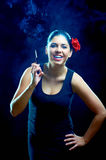 Laughing sexy chiquita with cigarette Stock Images