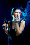 Laughing sexy chiquita with cigarette Royalty Free Stock Photos