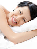 Laughing woman tries to fall asleep Stock Photos