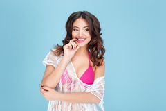 Laughing sexy young brunette woman in a pink bikini Royalty Free Stock Photo
