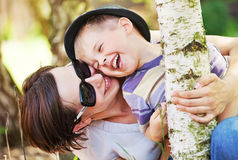 Laughing small boy hugged by his mother Royalty Free Stock Images
