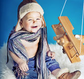 Laughing small boy with a toy aircraft Royalty Free Stock Photo