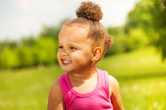 Laughing small girl on the nature background Royalty Free Stock Image