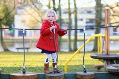 Laughing small girl playing in the park Royalty Free Stock Images