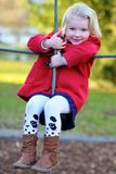 Laughing small girl playing in the park Stock Images