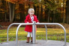 Laughing small girl playing in the park Royalty Free Stock Image