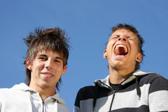 A laughing and a smiling teenager Royalty Free Stock Photo