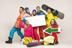 Laughing snowboarders presenting new equipment Stock Image
