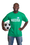 Laughing soccer fan from Nigeria with ball Royalty Free Stock Photography
