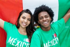 Laughing soccer fans from Mexico with mexican flag stock photos