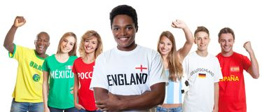 Laughing soccer supporter from England with fans from other countries stock photo