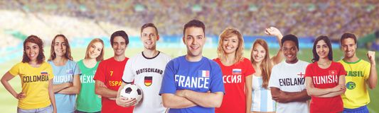 Laughing soccer supporter from France with fans from other count. Laughing soccer supporter from France with fans from Germany, Russia, Brazil and other Stock Image