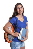 Laughing south american student with books Royalty Free Stock Photo