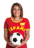 Laughing spanish girl with football Royalty Free Stock Photo