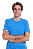 Laughing spanish guy in a blue shirt with crossed  Stock Images