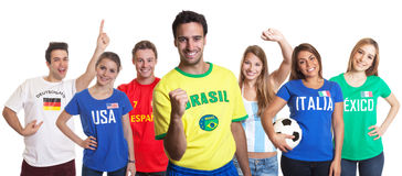 Laughing sports fan from Brazil with fans from other countries Royalty Free Stock Photography