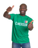 Laughing sports fan from Cameroon showing both thumb up Royalty Free Stock Photo
