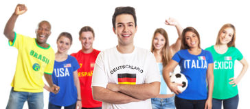 Laughing sports fan from Germany with fans from other countries Royalty Free Stock Photography