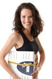 Laughing sporty woman with scale Royalty Free Stock Photos
