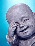 Laughing stone buddah Royalty Free Stock Image