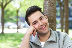 Laughing student in a grey jacket relaxing at the campus Stock Photos