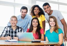 Laughing teacher with multicultural group of students stock photo