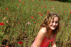 Laughing teen in flower field Stock Image