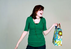 Laughing teen girl with gift bag Royalty Free Stock Photography