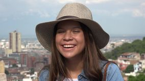 Laughing Teen Girl Having Fun Wearing Hat stock footage