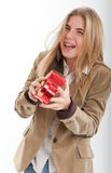 Laughing teen with heart shaped box Royalty Free Stock Image