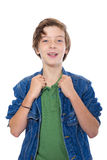 Laughing teenage boy with hands on his jacked collar, isolated o Stock Images