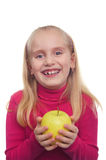 Laughing teenage girl with the yellow apple Royalty Free Stock Photos