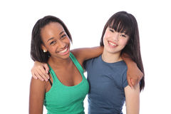 Laughing teenage girls african and Japanese. Laughing out loud are two happy beautiful teenage friends, a mixed race african american and oriental Japanese girls Stock Photography