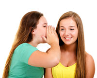 Laughing teenage girls whispering and gossiping Stock Photo