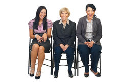 Laughing three business women on chair Stock Images