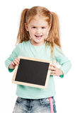 Laughing Three Year Old With Chalkboard. Funny girl holding chalkboard. Studio on white background Stock Photography