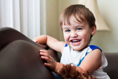 Laughing toddler boy with brown hair royalty free stock images