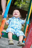 Laughing toddler boy riding Royalty Free Stock Photos