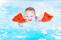 Laughing toddler girl having fun in swimming pool Stock Photography
